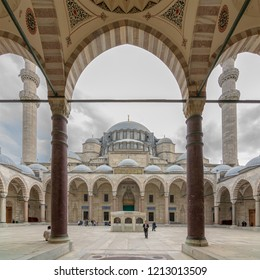 Istanbul, Turkey - April 17, 2017: Courtyard of Suleymaniye Mosque at early morning with few tourists visiting the place, an old Ottoman imperial mosque and the second largest mosque in the city