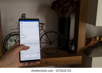 Istanbul/ Turkey - April 18, 2019 ; the woman use Samsung note 9 mobile phone, open apps Instegram , Whatsapp ,shopping is easy with technology,reading news.