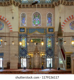 Istanbul, Turkey - April 19, 2017: Few people praying at Suleymaniye Mosque, an Ottoman imperial mosque built in 1557, located on the Third Hill of Istanbul and the second largest mosque in the city