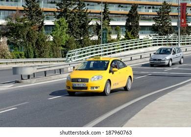 ISTANBUL, TURKEY - APRIL 19: Turkish taxi on the way, April 19, 2014 in Istanbul. 18,000 Istanbul taxi routes are on duty.
