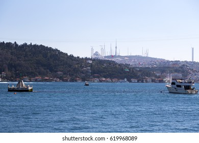 Istanbul, Turkey - April 2, 2017: Coastal view of Bebek district by the Bosphorus. Boats and yachts on the blue waters of the Bosphorus between the Asian and European continents.