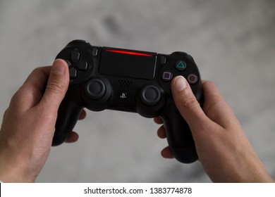 Istanbul / Turkey - April 20, 2019 ; Playstation 4 gaming console, adult playing video game in the home.