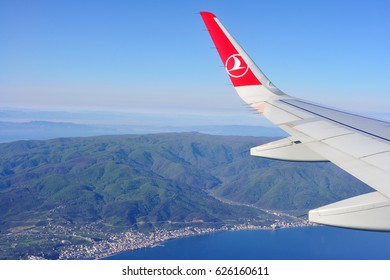 """ISTANBUL, TURKEY - APRIL, 2017: Wing of """"turkish airlines"""" airplane over Istabul"""