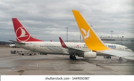 Istanbul, Turkey, April 2019: Pegasus airlines and Turkish airlines airplanes waiting on a terminal at new Istanbul Airport