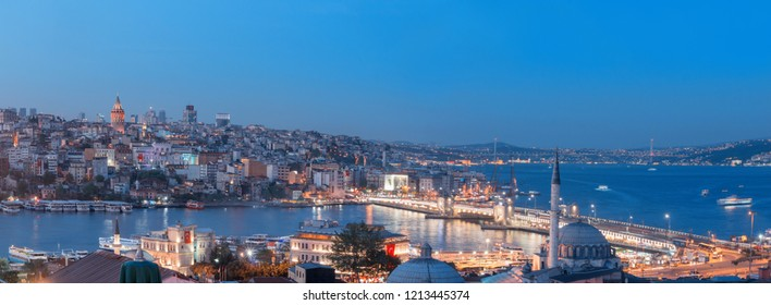 Istanbul, Turkey - April 22, 2016: Panoramic image of Istanbul with Galata Bridge and Yeni Cami Mosque at night