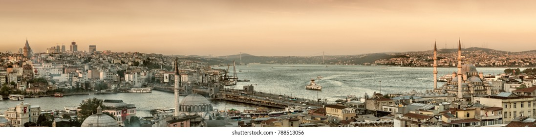 Istanbul, Turkey - April 22, 2016: Panoramic image of Istanbul with Galata Bridge and Yeni Cami Mosque during sunset