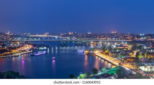 Istanbul, Turkey - April 22, 2017: Istanbul city view from Pierre Loti Teleferik station overlooking Golden Horn with Halic Bridge, Golden Horn Metro Bridge and historical mosques, Eyup District