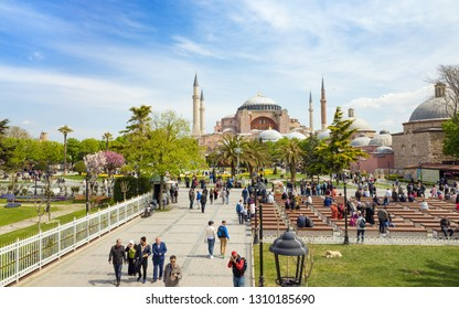 Istanbul, Turkey - April 22, 2017: Low aerial view of Sultanahmet district of Istanbul, Turkey. Walking tourists, green grass field near famous landmark Hagia Sophia.