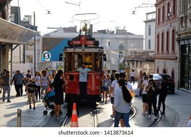 ISTANBUL, TURKEY - April 22, 2017: Nostalgic Red Tram of Istanbul. Historic tram in Taksim Istiklal Street. Touristic popular destination Taksim Istiklal Street. Beyoglu, Istanbul, Turkey.