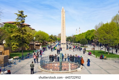 Istanbul, Turkey - April 22, 2017: Aerial view of Sultanahmet square of Istanbul, Turkey. People walking near famous landmarks Obelisk of Theodosius and Serpent Column.