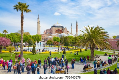 Istanbul, Turkey - April 22, 2017: Aerial view of Sultanahmet district of Istanbul, Turkey. Walking people, green grass field and fountain near famous landmark Hagia Sophia.