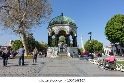 Istanbul, Turkey - April 23, 2018: People gather by the German Fountain in Sultanahmet Square.