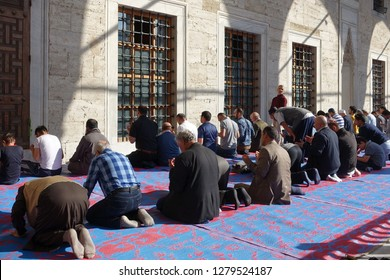 Istanbul, Turkey - April 23, 2018: Muslim men pray at the Blue Mosque or Sultan Ahmed Mosque.