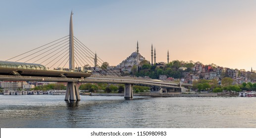 Istanbul, Turkey - April 24, 2017: Golden Horn Metro Bridge (Halic Bridge) overlapping Suleymaniye Mosque before sunset