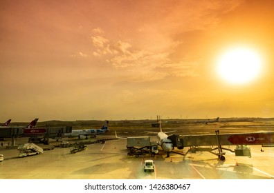Istanbul / Turkey - April 24, 2019:   International Airport in Istanbul, Turkey. Turkish airline plane ready to take off against the sunset sky.