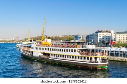Istanbul, Turkey - April 25, 2017: Local ferry departing Eminonu ferry terminal before sunset