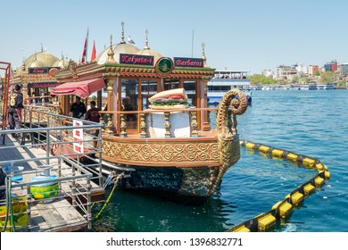 Istanbul, Turkey - April 25, 2017: Traditional fast food bobbing boat serving fish sandwiches at Eminonu with chefs preparing meals