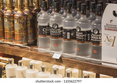 "Istanbul, Turkey - April 25, 2018: one-liter bottles of vodka Russian Standard with a price tag ""17,50 €"" on a shelf of a duty free shop in Istanbul Ataturk Airport."