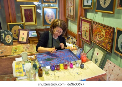 ISTANBUL, TURKEY - APRIL 27, 2017: Traditional Turkish art ebru in process. Painting on water, followed by paper prints.