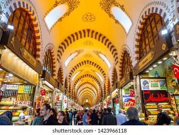 ISTANBUL, TURKEY - April 27, 2019: People shopping at Grand Bazaar Istanbul . The Spice Bazaar is one of the oldest bazaar in world.