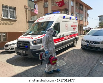 ISTANBUL, TURKEY - APRIL 27, 2020: Ambulance is waiting to take coronavirus patient on the street in Bagcilar