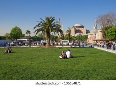 ISTANBUL, TURKEY - APRIL 27 : Tourists near Hagia Sophia on April 27, 2013 in Istanbul, Turkey. Hagia Sophia is a former Orthodox basilica, later a mosque, and now a museum.