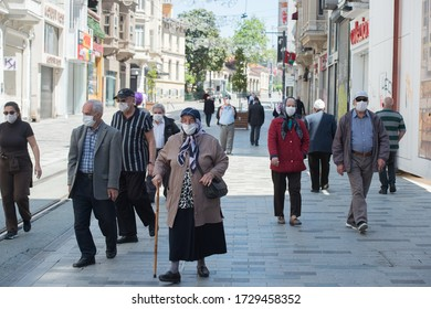 ISTANBUL, TURKEY - APRIL 29, 2020: People wearing masks in Istiklal Street due to coronavirus.