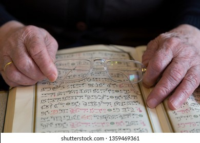 Istanbul / Turkey - April 4, 2019 ; the old woman reading Quran. Holy book Koran for Muslims holiday, Ramadan,blessed Friday message .