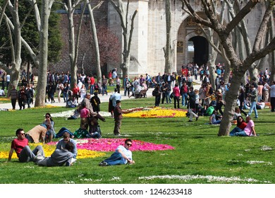 ISTANBUL, TURKEY - APRIL 8, 2012: People relax and enjoy warm spring weather in Gulhane park, the oldest public park in Istanbul located near historical Topkapi Palace.