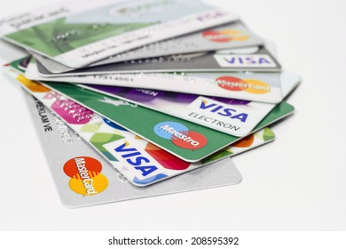 Istanbul, Turkey - August 01, 2014: Pile of credit cards, Visa and MasterCard, credit, debit and electronic