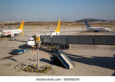 ISTANBUL, TURKEY - August 03, 2015: Sabiha Gokcen airport. Airport jet bridge. Airport jetway, aerobridge, skybridge. Passenger boarding bridge. Airport air bridge. Pegasus airlines aircraft.