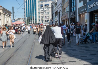 ISTANBUL, TURKEY - AUGUST 07, 2019: Middle Eastern tourists walking on Taksim (Beyoglu) street.