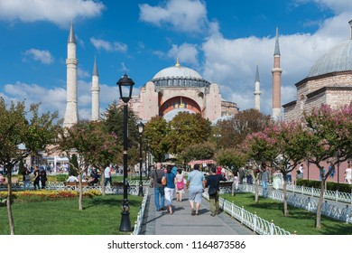 ISTANBUL, TURKEY, AUGUST 1, 2018: People walking at Sultanahmet Square, Hagia Sophia can be seen at the background. Sultanahmet District is the heart of old Istanbul.