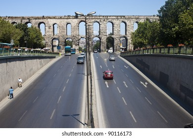ISTANBUL, TURKEY - AUGUST 1: Aqueduct of Valens on August 1, 2011 in Istanbul, Turkey. Aqueduct was completed in 368 by Roman Emperor Valens. Today,  busy Ataturk boulevard leads under its bridge.