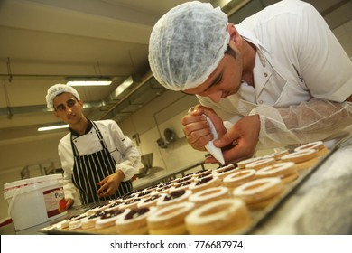 ISTANBUL, TURKEY - AUGUST 10: Turkish chefs making 'Mini Tartlets' in the baker factory on August 10, 2017 in Istanbul, Turkey.