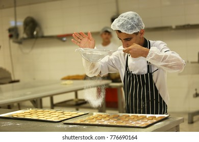 ISTANBUL, TURKEY - AUGUST 10: Turkish chefs making cookies in the baker factory on August 10, 2017 in Istanbul, Turkey.