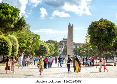 ISTANBUL, TURKEY, AUGUST 11, 2018: People walking at Sultan Ahmet Square (The Old Hippodrome Of Constantinople), famous tourist attraction and landmark of Istanbul's historic peninsula.