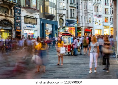 ISTANBUL, TURKEY - August 11, 2018: Street seller of fast food with boiled and grilled corn and chestnut on traditional turkish cart near Taksim