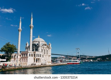 Ortaköy, Istanbul / Turkey - August 12, 2018 : Panaromic view of the Ortaköy Mosque and the Bosphorus Bridge in the background. Famous with kumpir (baked potatoes) and Bosphorus tours.
