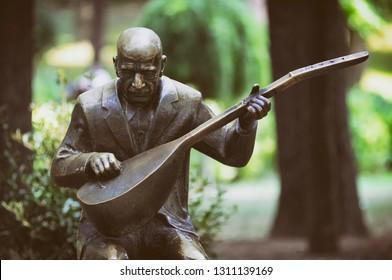 ISTANBUL, TURKEY, AUGUST 13, 2011: Statue of Asik Veysel (Satiroglu), a Turkish minstrel and highly regarded poet of the Turkish folk literature at Gulhane Park, Istanbul, Turkey.