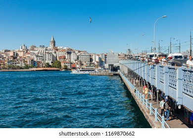 Istanbul, Turkey - August 14, 2018: Men catch fish from the Galata Bridge on August 14, 2018 in Istanbul, Turkey.