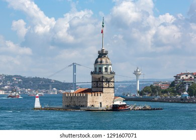 ISTANBUL, TURKEY - AUGUST 14, 2018: In the building at the Bosphorus was a prison, post office. It was also the Maiden tower according to legend. The restaurant is now