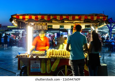 ISTANBUL, TURKEY - AUGUST 14: Street food vendor sells corn cobs and roasted chestnuts on the street of Istanbul on August 14, 2018 in Istanbul, Turkey.