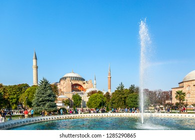 Istanbul, Turkey - August, 2018: Hagia Sophia Ayasofya museum with fountain in the Sultanahmet Park in Istanbul, Turkey during sunny summer day.