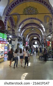 ISTANBUL, TURKEY, AUGUST 21, 2014: People are passing through bazaar of istanbul - one of the most famous places, where people every day buying various items.