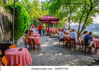 ISTANBUL, TURKEY, AUGUST 23, 2014: People are sitting pierre loti restaurant situated in the middle of graveyard in Istanbul.