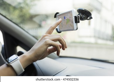 ISTANBUL, TURKEY - AUGUST 26, 2016: Woman hands holding iPhone 6 with Apple Maps in the screen on the multimedia system. iPhone, Apple Maps was created and developed by the Apple inc.