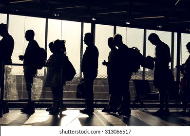 Istanbul, Turkey, August 27, 2015: People are waiting in the Ataturk airport terminal with their silhouette reverse lighted image