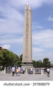 ISTANBUL, TURKEY - August 3, 2014.  People walking around the Obelisk of Theodosius.