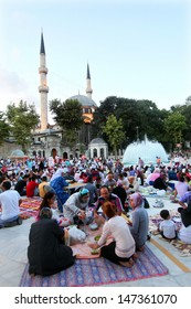ISTANBUL, TURKEY - AUGUST 8: People waiting The Iftar near the Eyup Sultan Mosque at Ramadan on August 8, 2011 in Turkey. Built in 1458, first mosque constructed by the Ottoman Turks in the city.